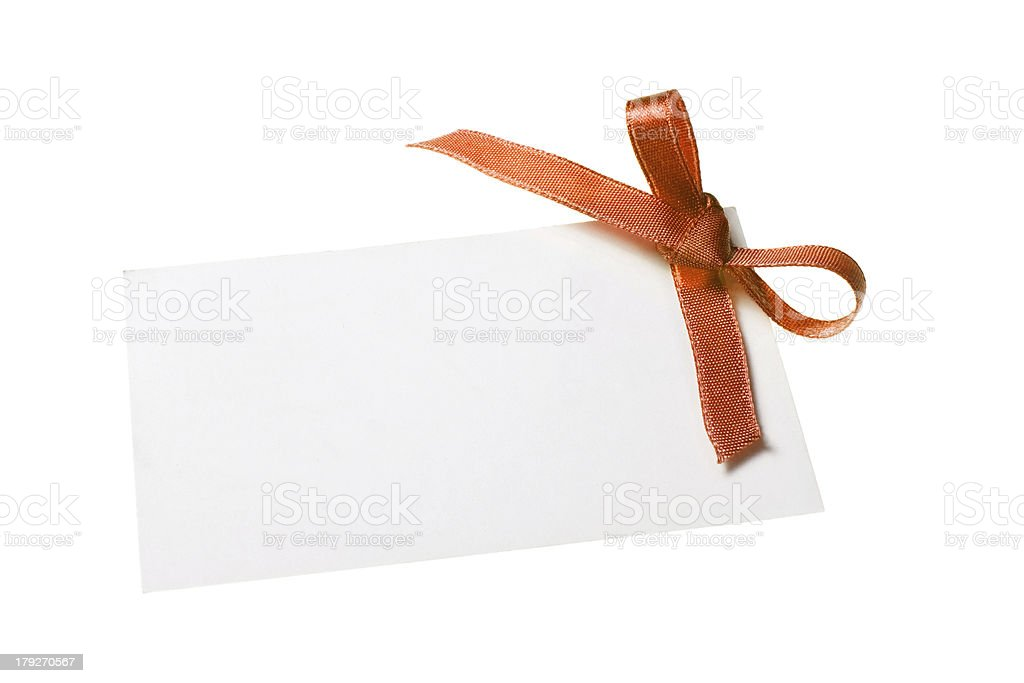 Blank gift tag tied with a bow of satin ribbon royalty-free stock photo