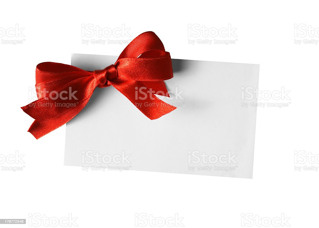 Blank gift tag with red bow on white background royalty-free stock photo