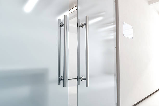 Blank glass door with metal handles mock up, stock photo
