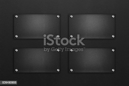 153984410istockphoto Blank glass plate with black textured background 526490905