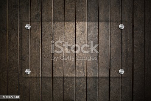 153984410istockphoto Blank glass plate with wood background 526427615
