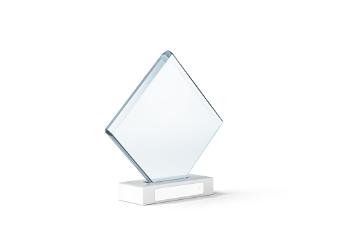 istock Blank glass trophy mockup stand on clear marble base, 639317572