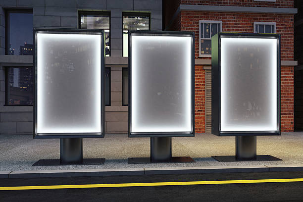 Blank glowing posters on empty night city streets, mock up Blank glowing posters on empty night city streets, mock up medium group of objects stock pictures, royalty-free photos & images