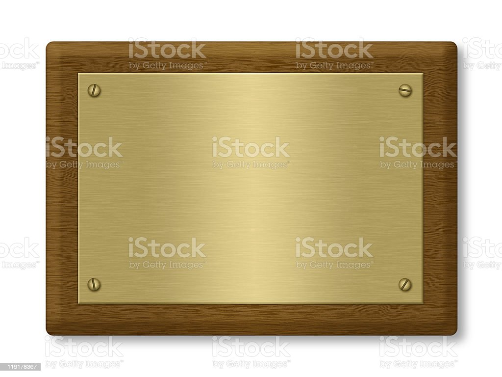 A blank gold plaque on a wooden support stock photo