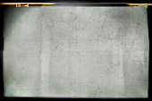 istock Blank grained and scratched film strip texture background 1051370904