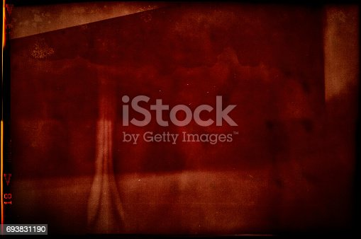 874803346 istock photo Blank grained and scratched film strip texture 693831190