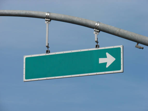blank green sign with arrow stock photo