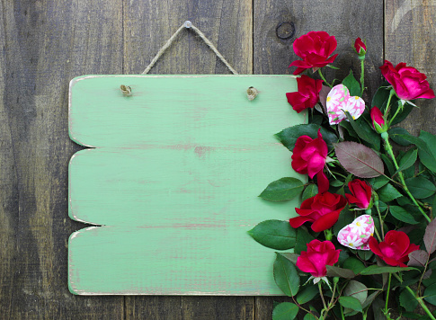 Blank green sign with red rose border