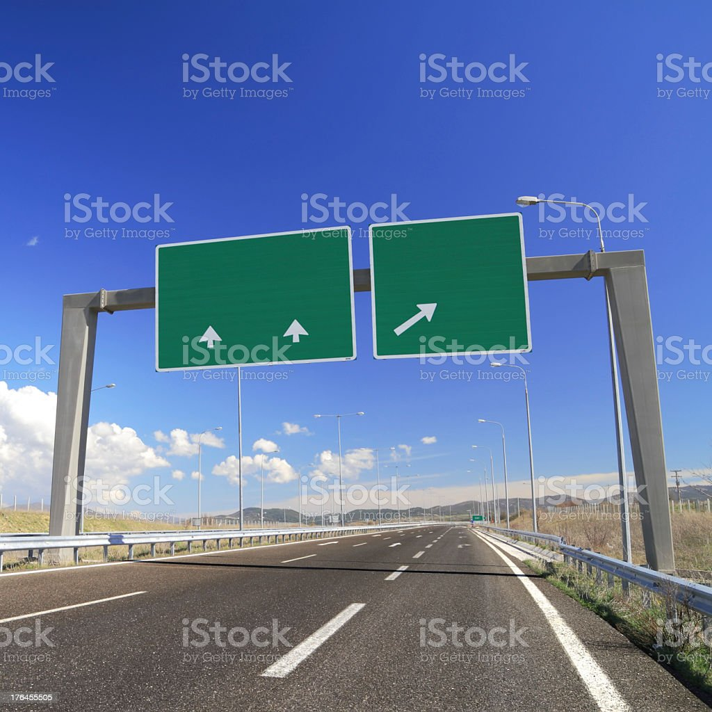 Blank green signs with arrows on empty highway stock photo