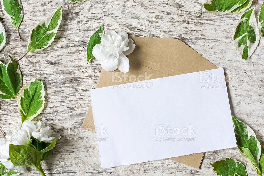 Blank greeting card and envelope with jasmine flowers stock photo