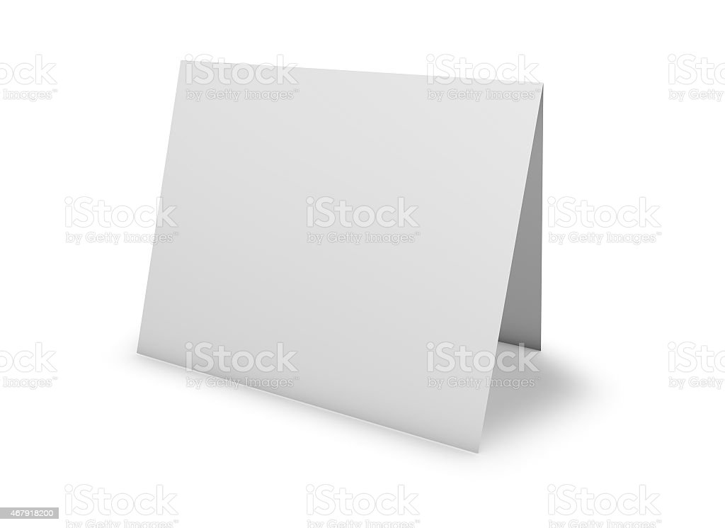 Blank greeting card standing on floor, isolated on white. stock photo