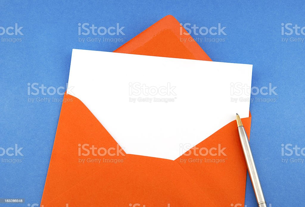 Blank greeting card with pen in orange envelope royalty-free stock photo