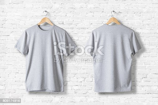 istock Blank Grey T-Shirts Mock-up hanging on white wall, front and rear side view . Ready to replace your design 809174916