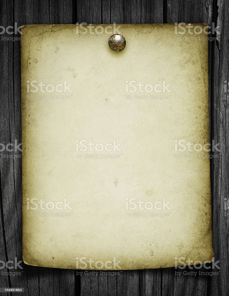 Blank Grungy Paper Tacked to a Wood Post royalty-free stock photo