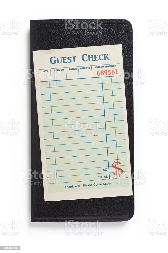 Blank guest check on black background stock photo