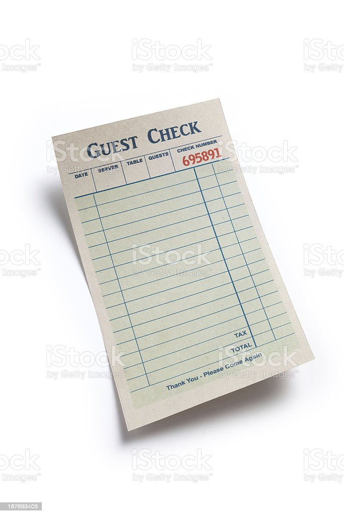 A blank guest check sitting on a white background stock photo