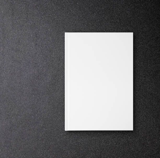 blank hardcover canvas book mock up for design book cover on black table - magazine cover stock photos and pictures