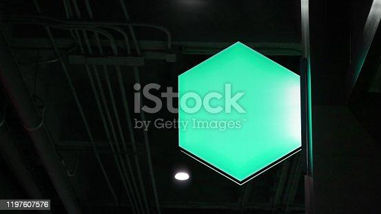 1140718043 istock photo Blank hexagon lightbox signage hang on wall 1197607576