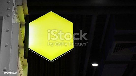1140718043 istock photo Blank hexagon lightbox signage hang on wall 1199038927