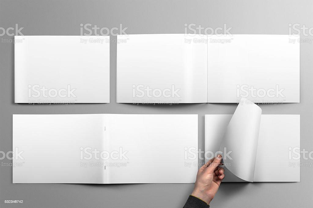 Blank horizontal brochure mockup on light grey background. stock photo