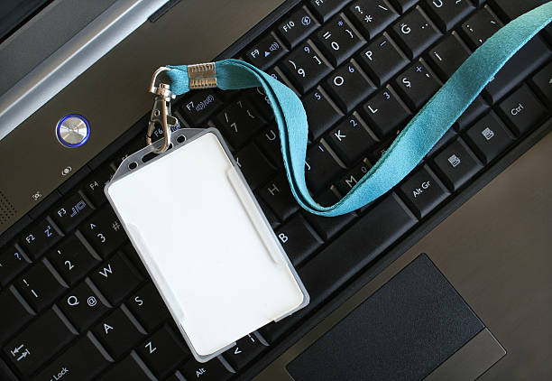 Blank ID card / badge on laptop /notebook Blank ID card / badge on laptop /notebook security pass stock pictures, royalty-free photos & images