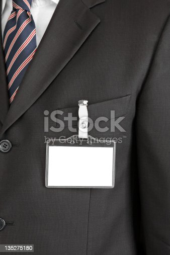 man with blank id card on suit