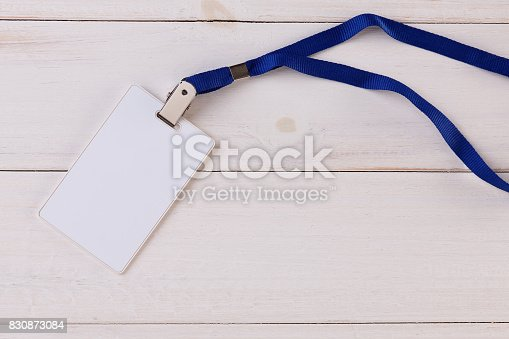 istock Blank Identification Card with Neckband on White Wooden Background 830873084