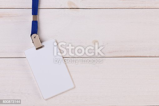 istock Blank Identification Card with Neckband on White Wooden Background 830873144