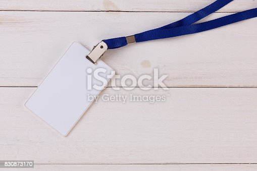 istock Blank Identification Card with Neckband on White Wooden Background 830873170