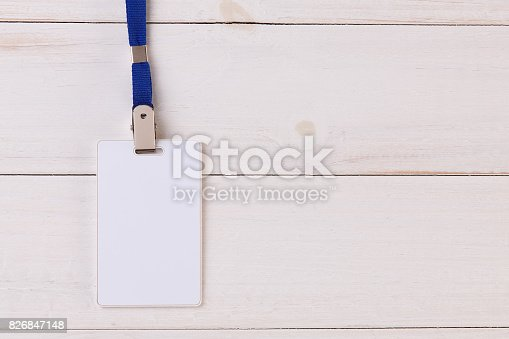 istock Blank Identification Card with Neckband on Wooden Background 826847148