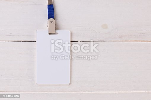 istock Blank Identification Card with Neckband on Wooden Background 826847150