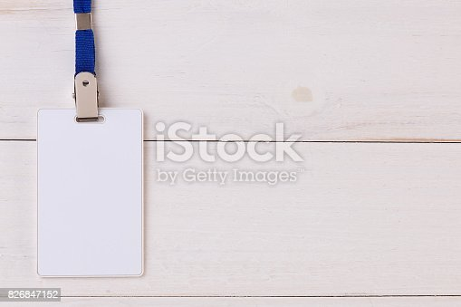istock Blank Identification Card with Neckband on Wooden Background 826847152