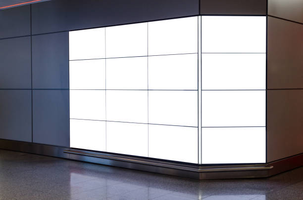 Blank illuminated advertising board with copy space The photo was taken at an airport terminal and is showing advertising space that is left blank. You can use the billboard for your own advert or design idea. electronic billboard stock pictures, royalty-free photos & images