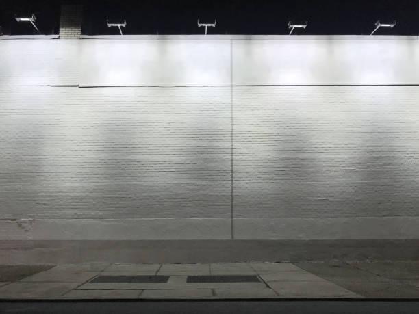 Blank illuminated wall stock photo