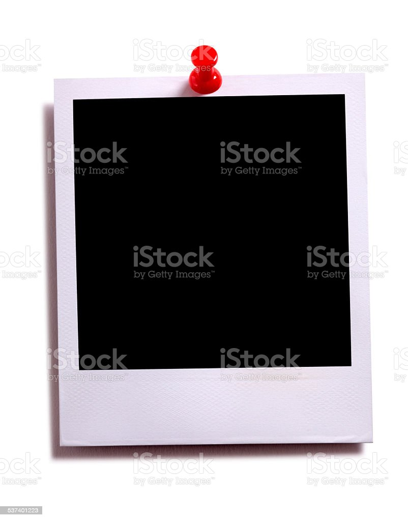 Blank instant camera photo print with red pushpin stock photo