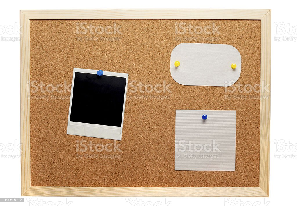 Blank instant photo and note papers on a cork board royalty-free stock photo