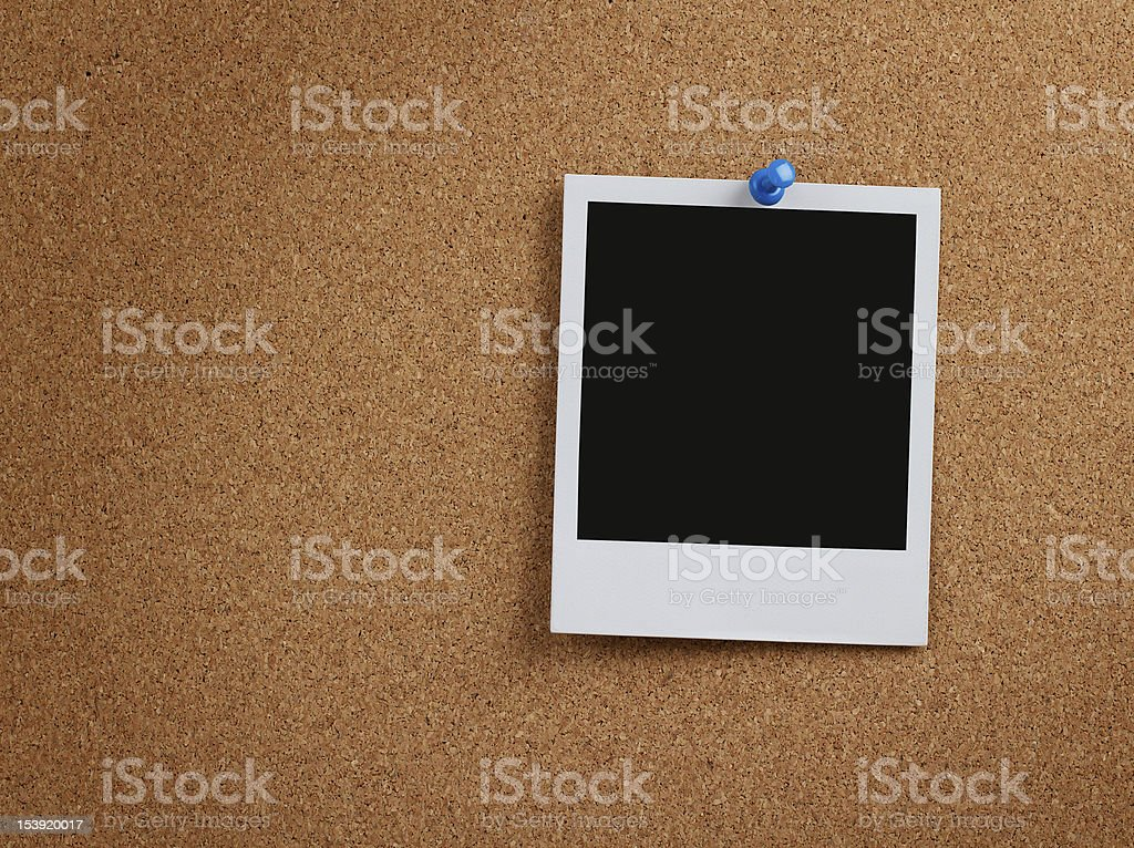 Blank instant photo at cork board stock photo