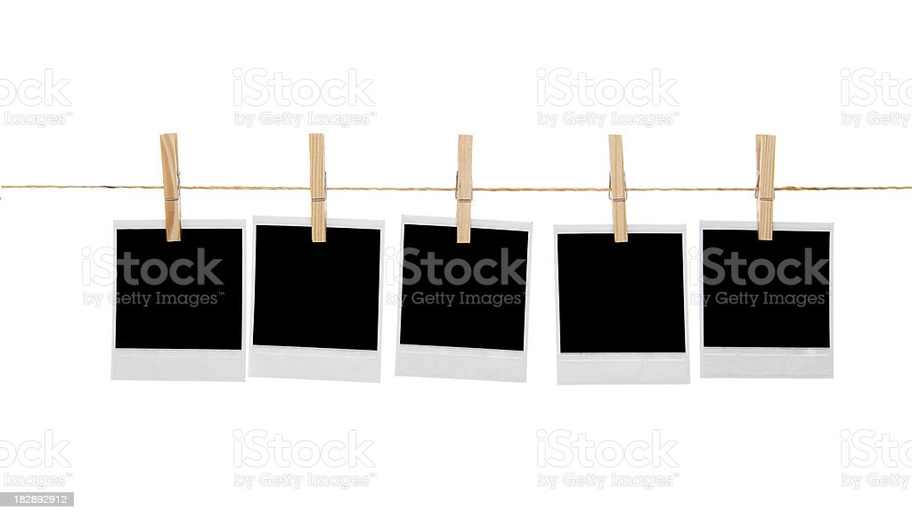 Blank instant photo prints on a washing line royalty-free stock photo