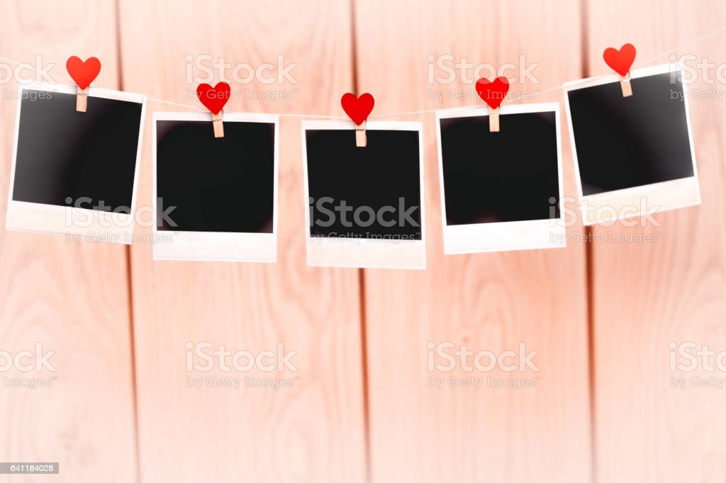 Blank instant photos hanging on the clothesline stock photo