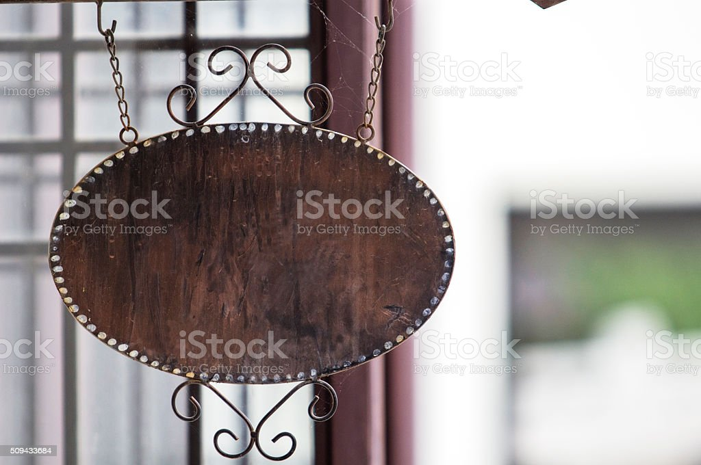 blank iron shop sign stock photo