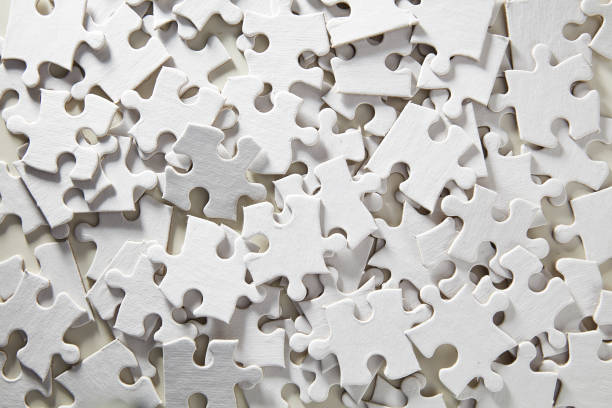 Blank Jigsaw Puzzle random Jigsaw Puzzle unassembled in white jigsaw piece stock pictures, royalty-free photos & images