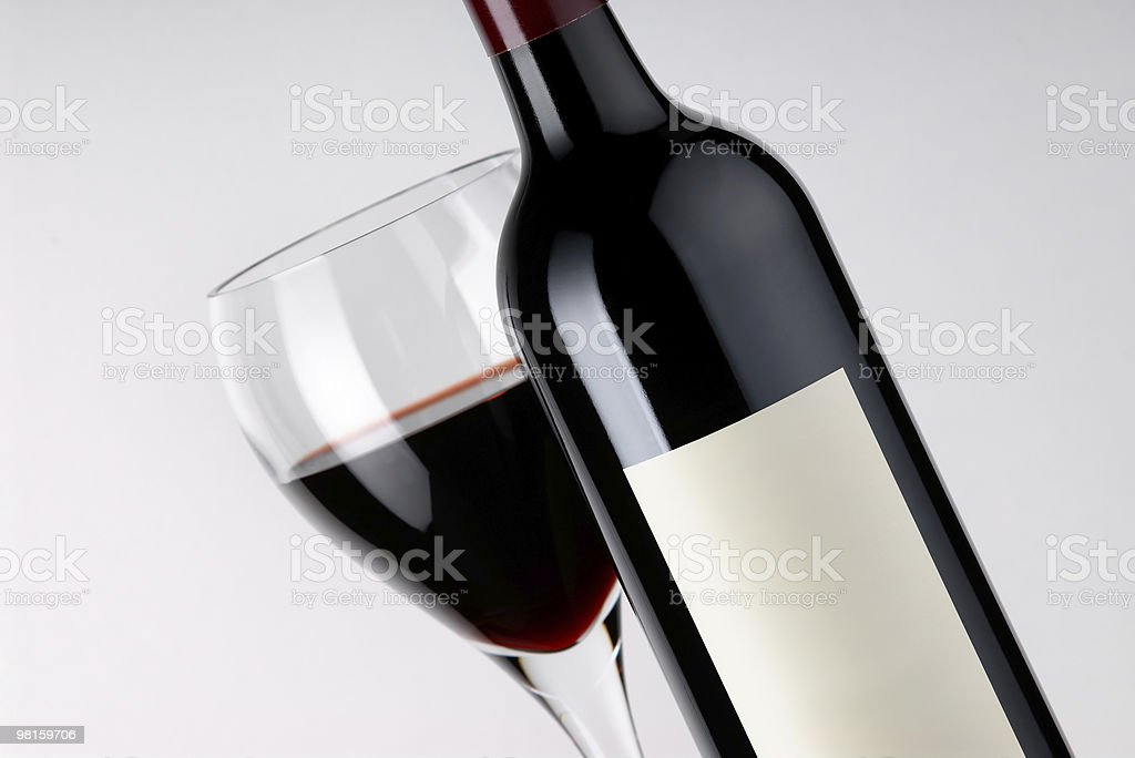Blank Label Clearskin Wine Bottle and Full Glass royalty-free stock photo