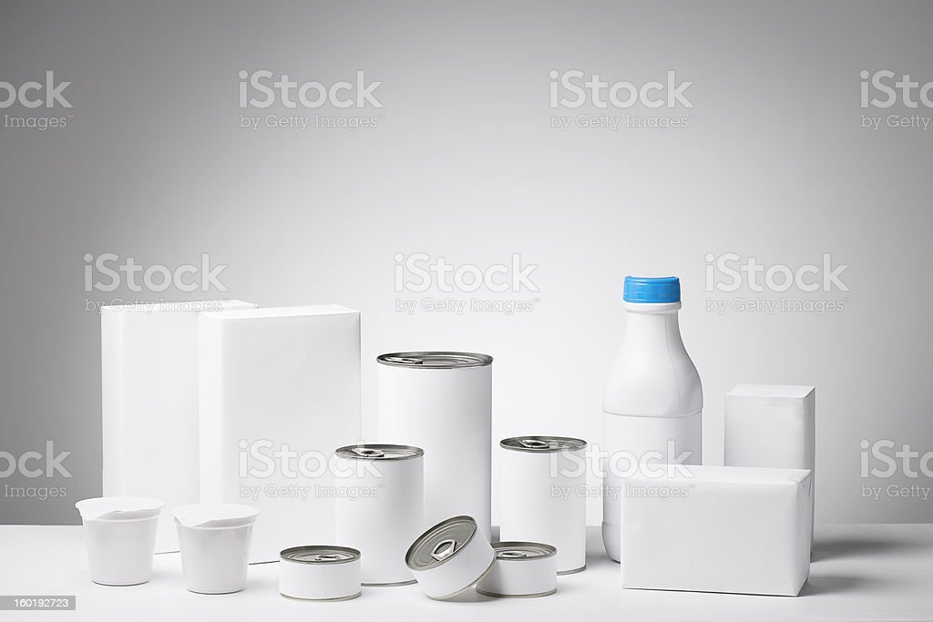 Blank labeled products on neutral white to gray gradient background stock photo