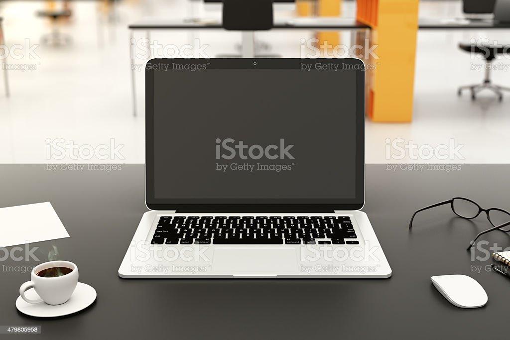 Blank laptop on a modern workplace stock photo