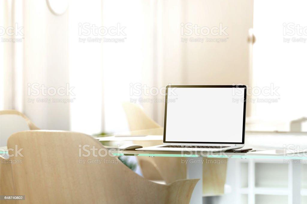 Blank laptop screen mockup in office, depth of field effect stock photo