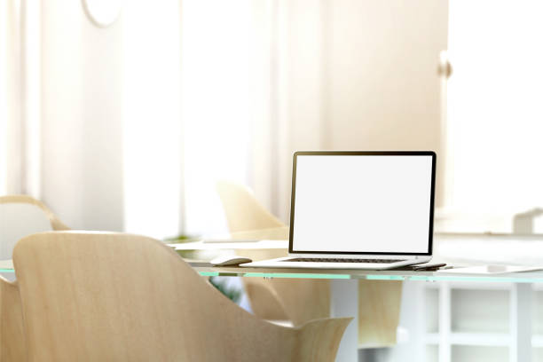 Blank laptop screen mockup in office, depth of field effect stock photo