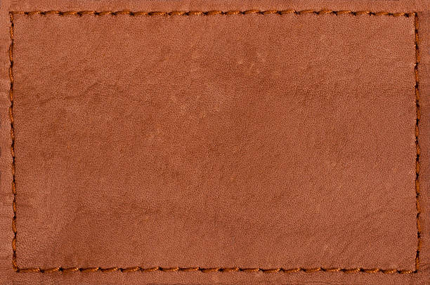 Blank leather jeans label isolated on white background Leather blank jeans label... stitching stock pictures, royalty-free photos & images