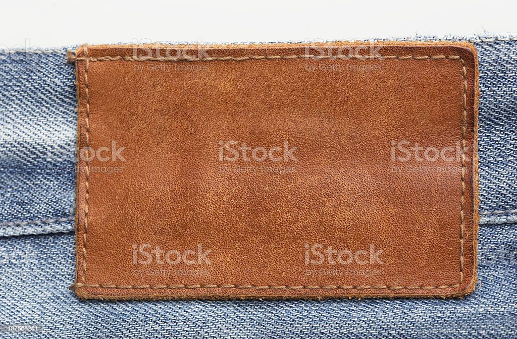 Blank leather jeans label on blue jeans royalty-free stock photo