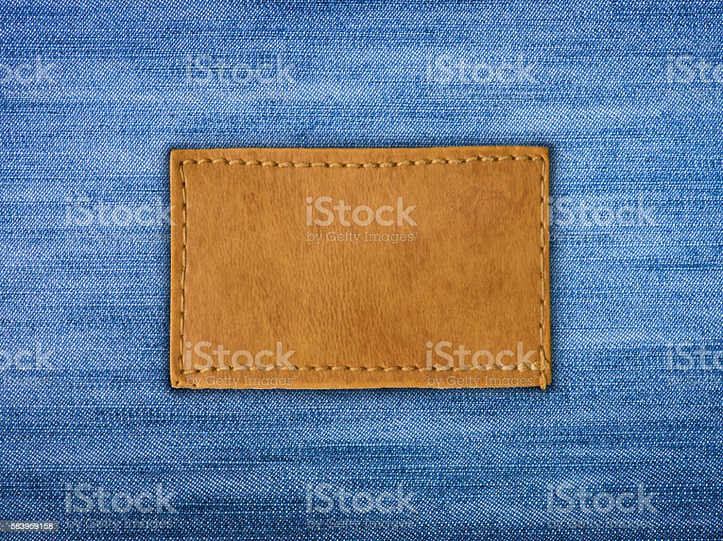 Blank leather jeans label sewed on a blue jeans stock photo