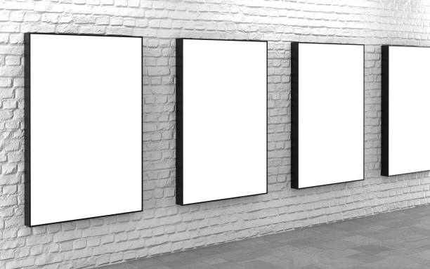 Blank lightboxes on white brick wall stock photo
